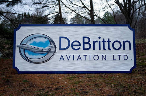 DeBritton Aviation Airport Business Sign blue border chiseled background with airplane and cloud logo image