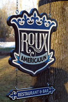 Side view of Roux restaurant sign
