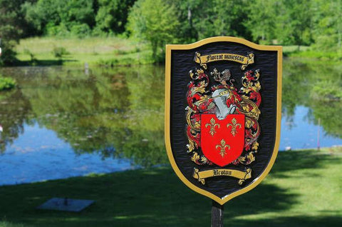 Custom carved family crest with black background