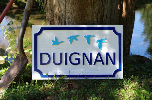 Duignan family name carved sigh with ducks