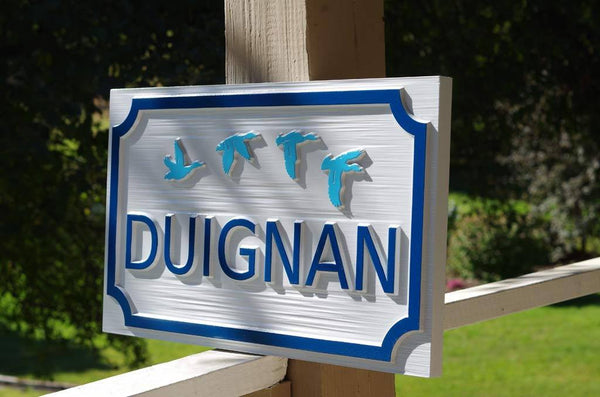 side view of Duignan family name carved sigh with ducks