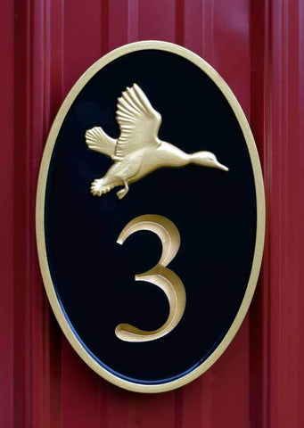 House number sign with 3d flying duck