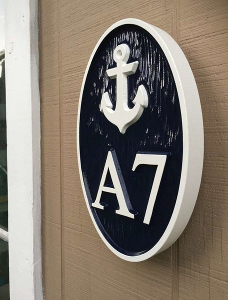 Custom made oval house number and letter sign with anchor painted black and white