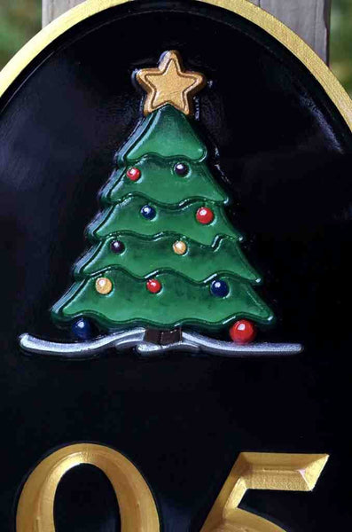 Close up of hand painted Christmas tree on house number sign