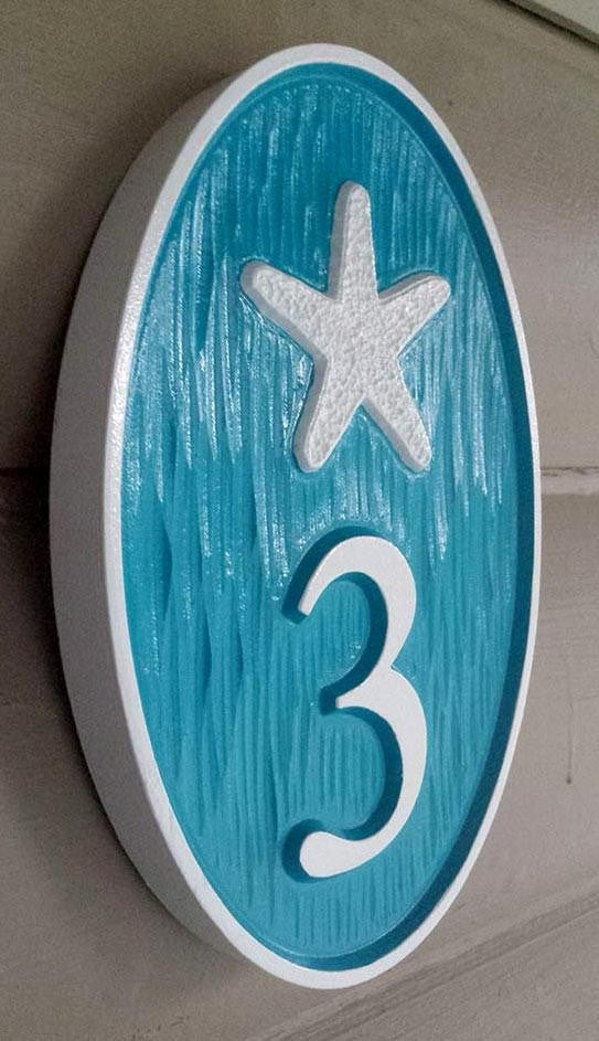 Custom made oval house number with starfish painted sea blue and white