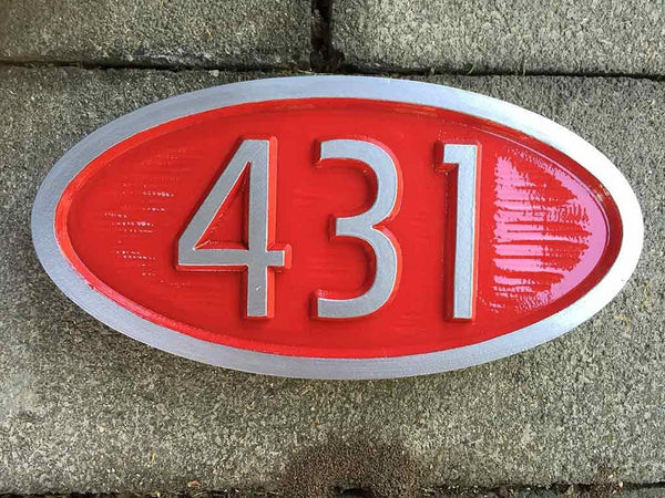 custom carved house number sign with 431 painted red and silver retro style
