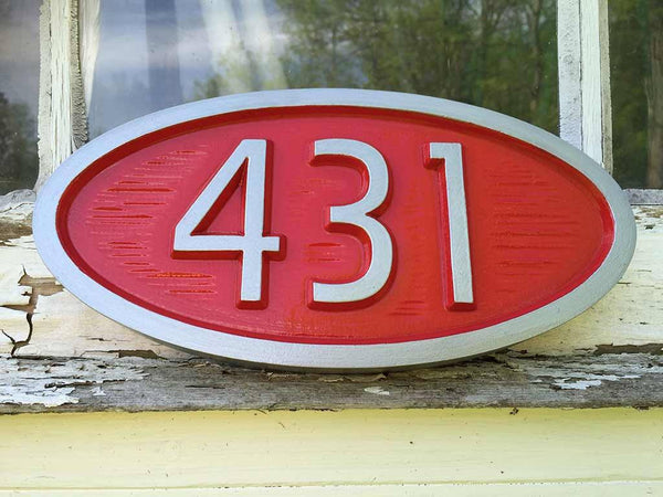 custom carved oval house number sign with 431 painted red and silver retro style