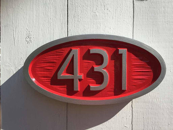 custom carved house number sign with 431 painted red and silver mid century modern style