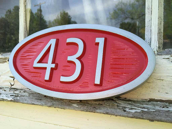custom carved oval house number sign with 431 painted red and silver mid century modern style