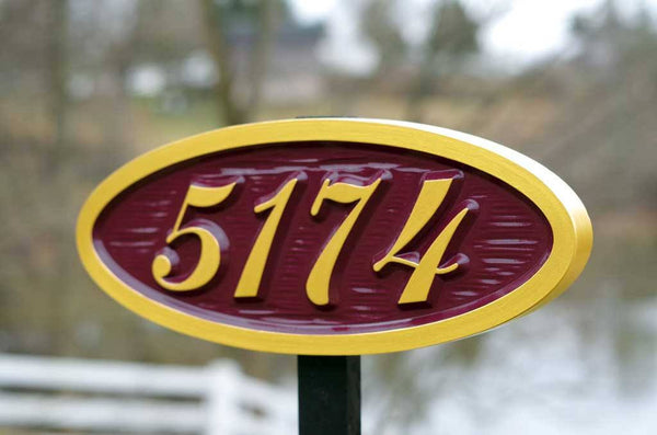 5174 oval house number sign on post