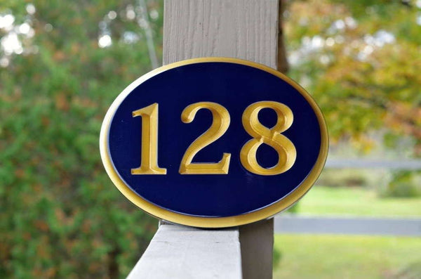 Custom carved oval house number painted navy blue and gold