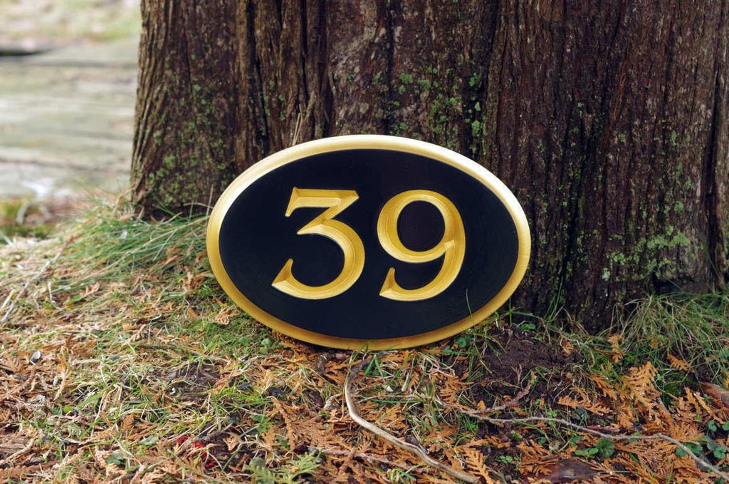 House number 39 painted black and gold