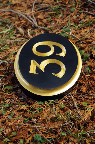 Custom carved house number 39 painted black and gold