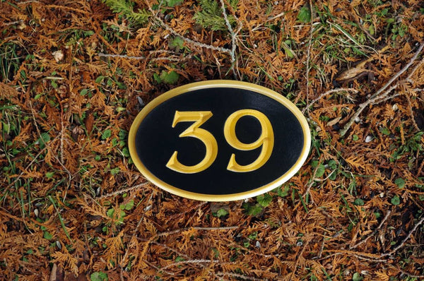 Custom made oval house number painted black and gold