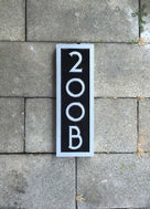 Custom made address number with letter rectangular sign painted black and silver