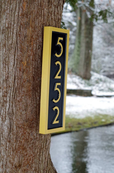Side view of House number sign 5252 in black and gold mid century modern font