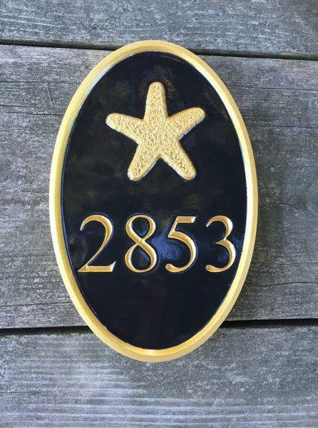 Custom carved house number sign with four numbers and starfish image