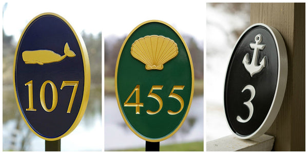 three pictures of oval house number signs with whale and scallop shell and anchor carved on each one