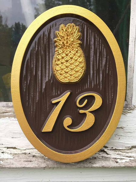 Custom carved house number address sign with a pineapple and 13oval shape painted brown and gold