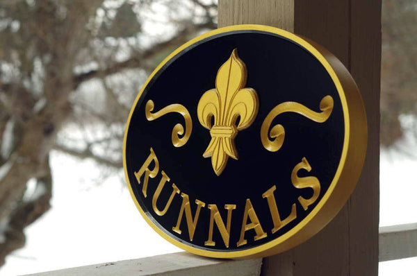 side view of custom carved last name sign with fleur-de-lis