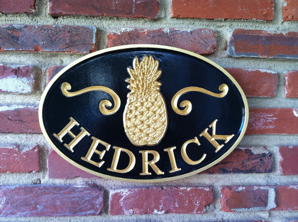 Oval last name sign with welcome pineapple and scrolls