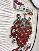 Close up of Mccullough Family Coat of Arms carved and painted