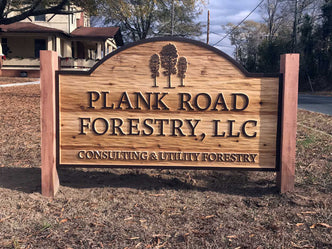 Plank Road Forestry wood carved sign