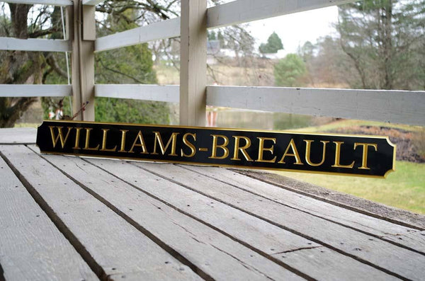 Custom quarterboard sign with Williams-Breault last name in black and gold