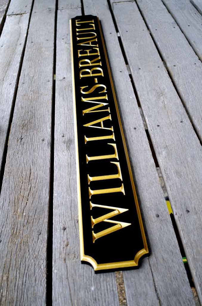 Custom quarterboard sign with Williams-Breault last name in black and gold side view
