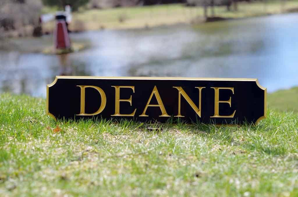 Deane quarterboard posed on ground painted black and gold