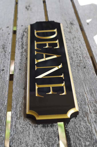 Deane quarterboard posed on ground painted black and gold right side view