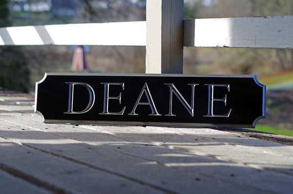 Deane quarterboard posed on ground painted black and silver
