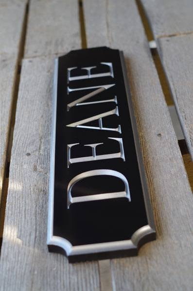 Deane quarterboard posed on ground painted black and silver left side view