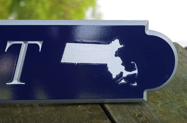 Custom Carved quarterboard with close up of Massachusettes state carved on it