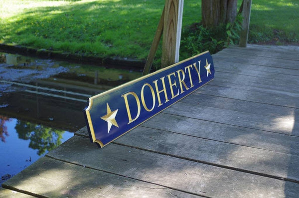 Personalized carved quarterboard with name carved on it and flanking stars side view