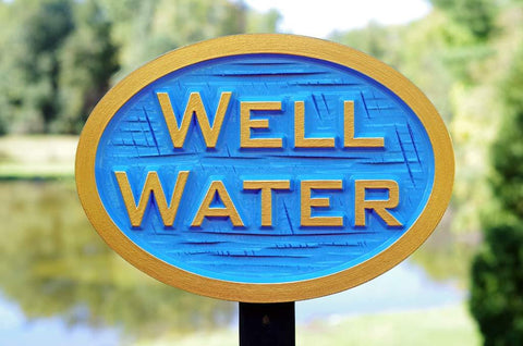 Blue and gold Well Water sign