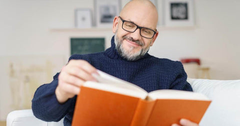 balding man reading about dht and hair loss