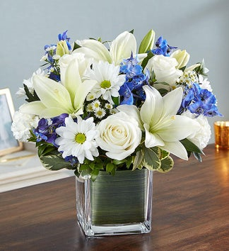 white lilies and roses in vase arrangement sympathy