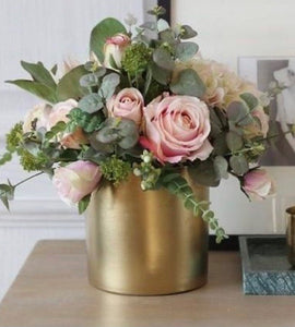 blush pink roses in a modern gold vase
