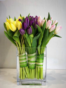 tulip arrangement in a glass vase