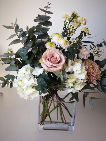 soft, modern flowers in a cleaver vase arrangement. flower delivery for mothers day in richmond, bc