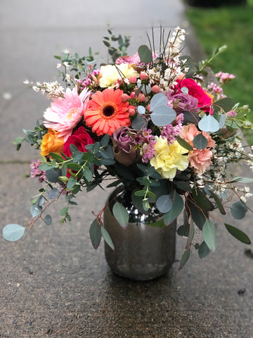 cheerful flowers in a silver vase arrangement. flower delivery for mothers day in richmond, bc