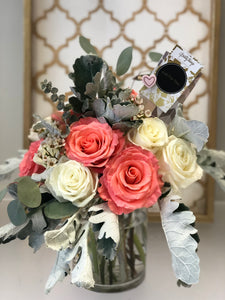 mothers day rose arrangement.coral pink and white roses with greenery
