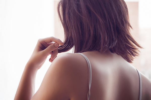Back of a woman with short brown hair