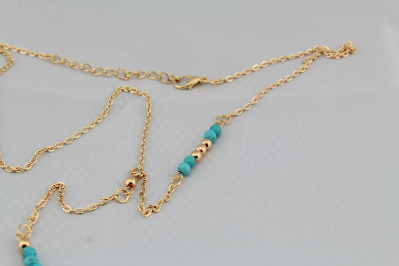 Gold Boho Feather Necklace With Handmade Turquoise Beads