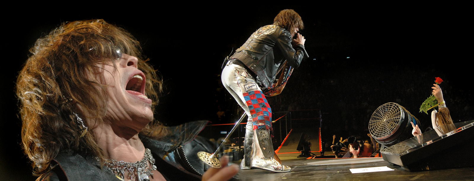 Steve Tyler lead singer Aerosmith in concert photo.