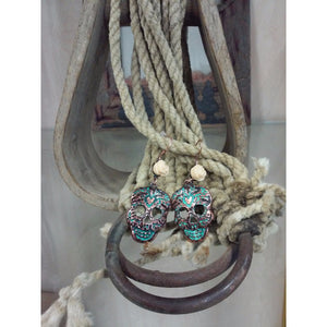 patina colored sugar skull earrings with ivory colored rose