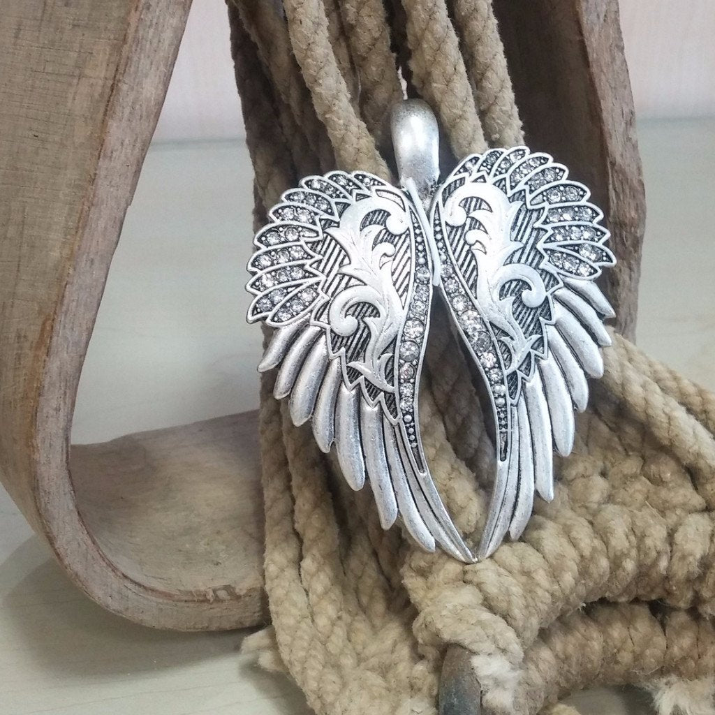 wings with bling pendant
