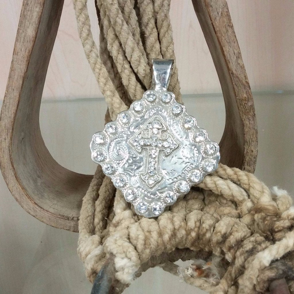 diamond shaped pendant with cross and clear rhinestones