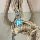 antique silver concho pendant with blue crystals